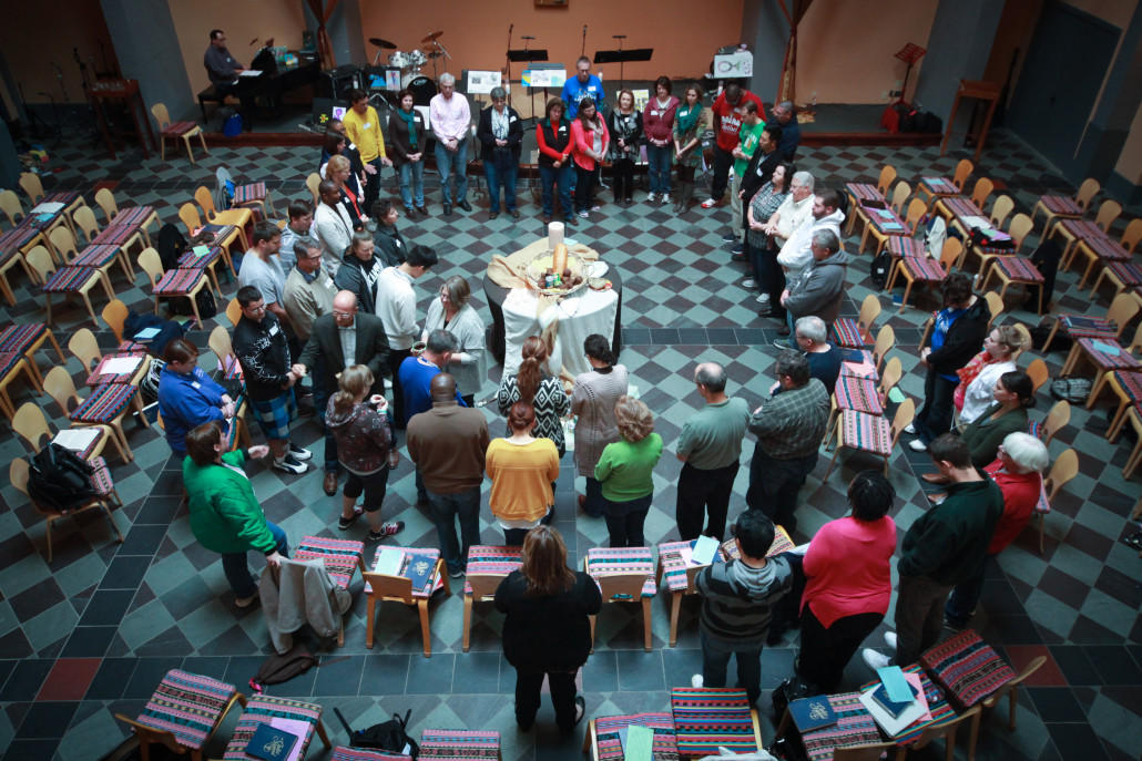 large group gathers in circle during spiritual formation retreat