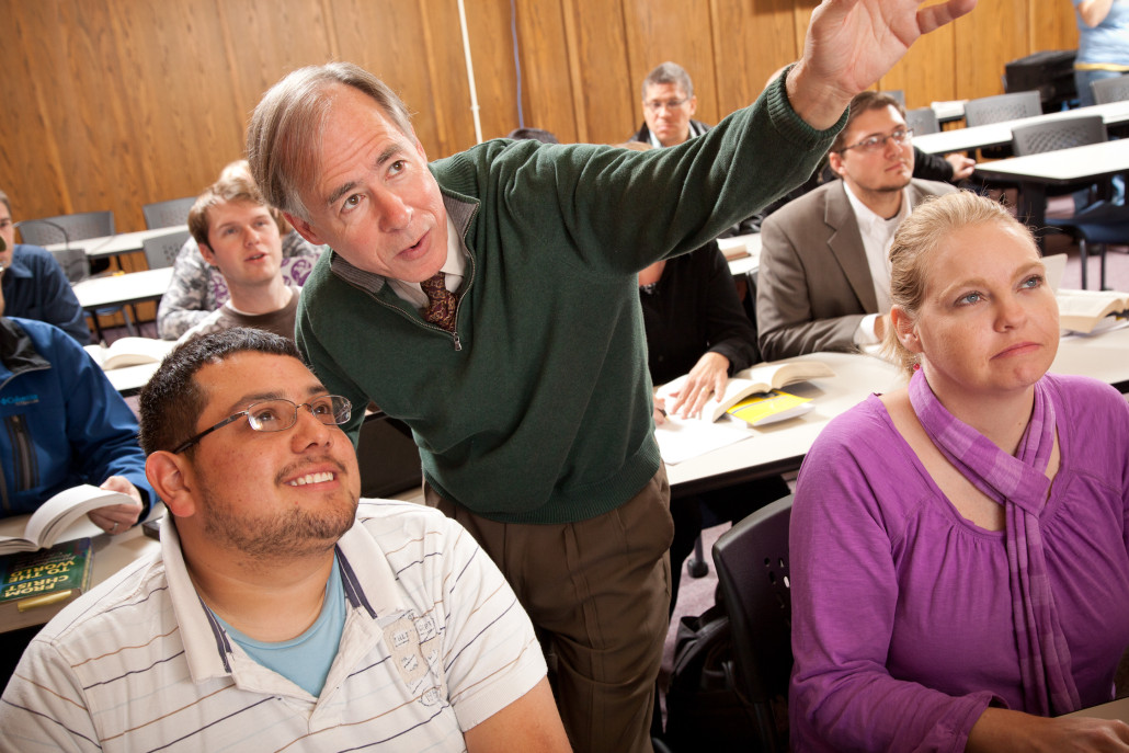 instructor guides students in activity in Oklahoma Seminary class
