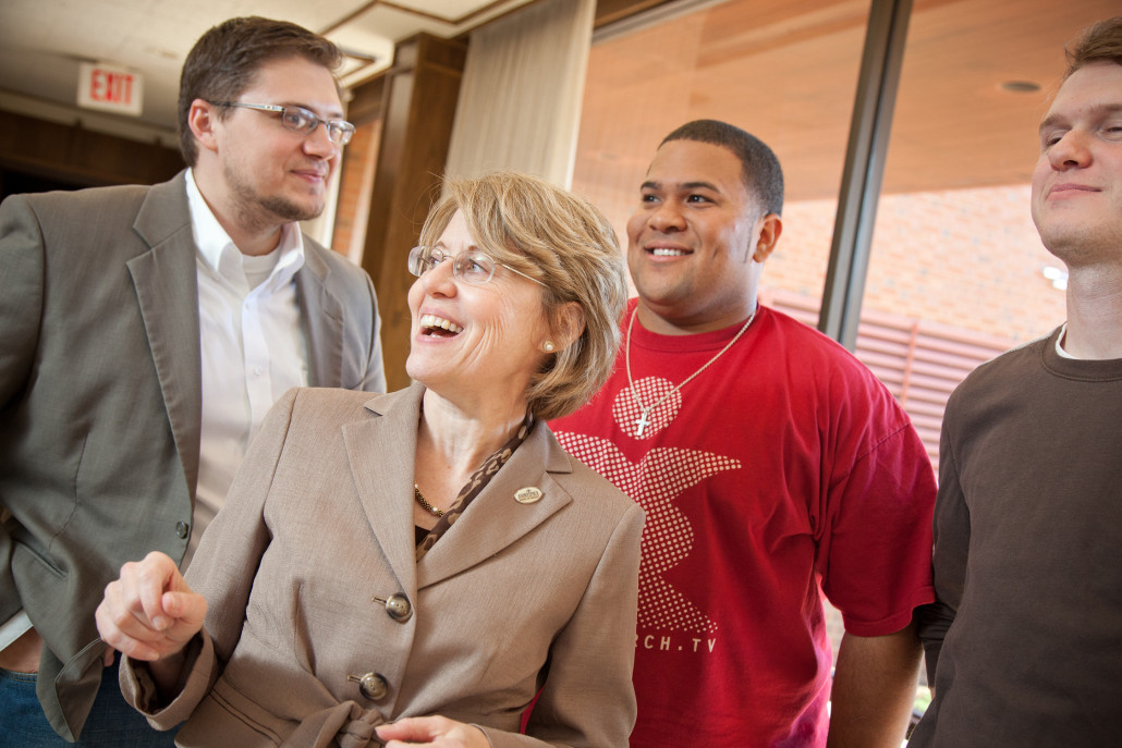 instructor laughs with Oklahoma seminary students in hallway