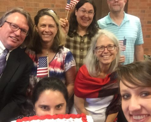 OCU staff and students celebrate Constitution Day with a cake.