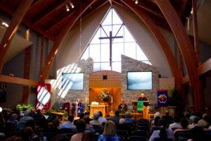 Congregation and preacher inside Saint Paul School of Theology church.