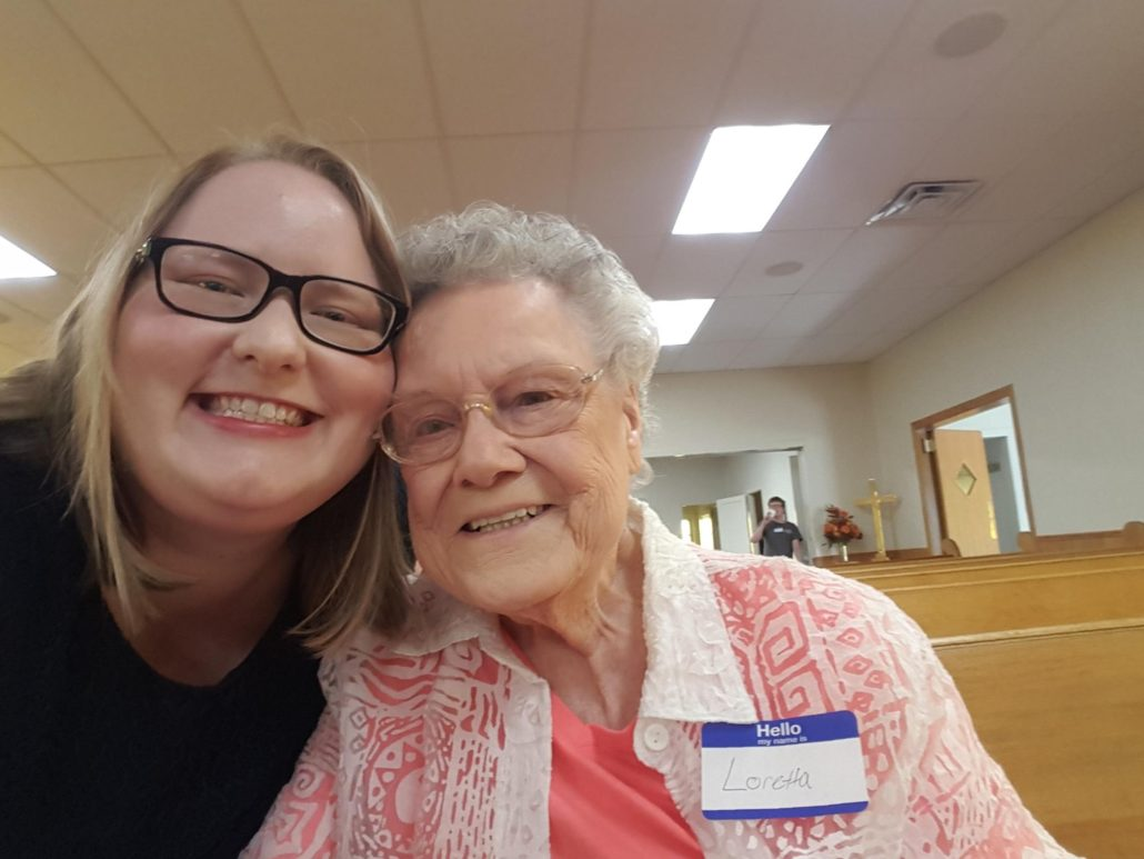 MDiv Shannon Rodenberg pictured with congregant.