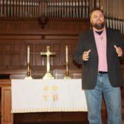 Photo of Iowa Student Fredrick Killian preaching as part of his divinity degree.