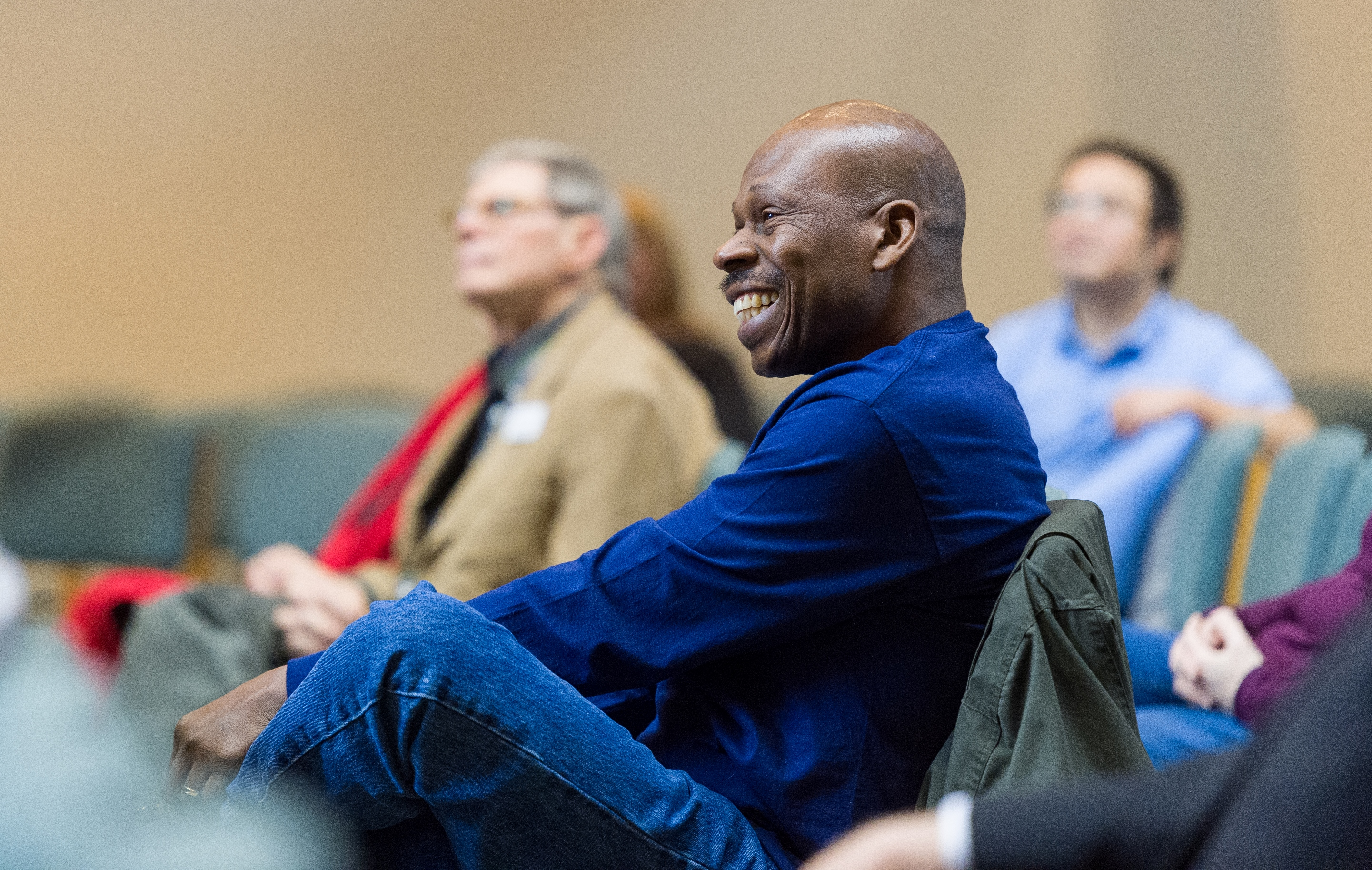 man smiles during theological seminary session