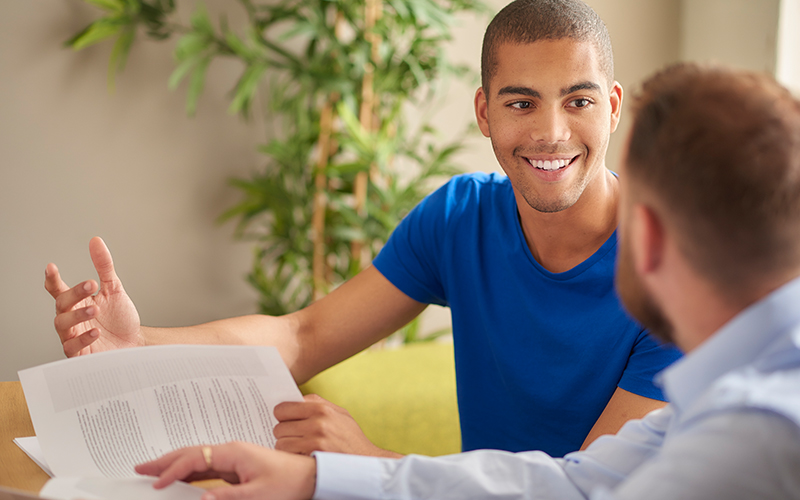 Male mentor working with male student