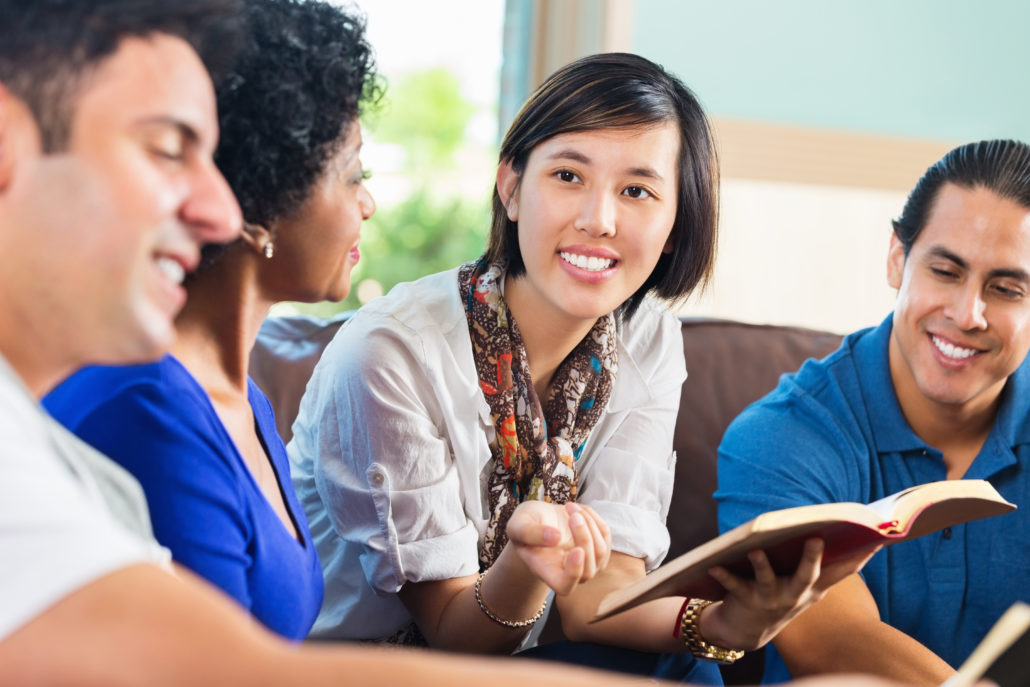 Young woman leading Bible discussion group