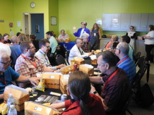 Alumni enjoying a meal at a reunion