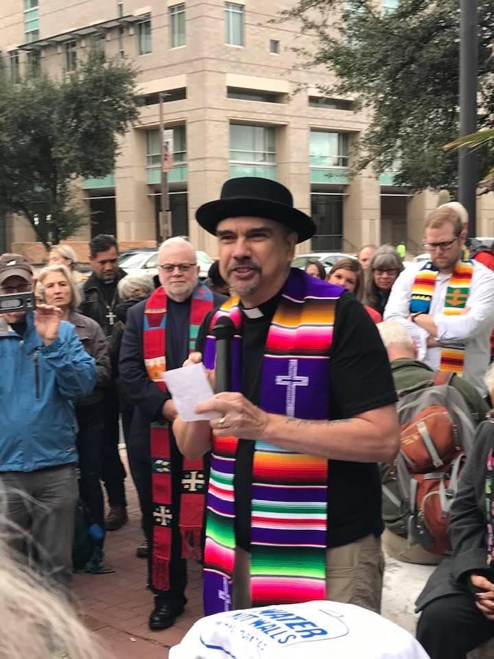 Rev. Dr. Miguel De La Torre attends a Tuscon protest