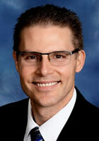 headshot of Reverend Dr. Dustin Petz